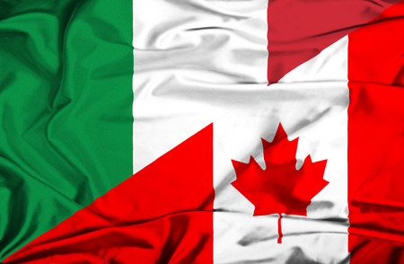 Waving flag of Canada and Italy Stock Photo
