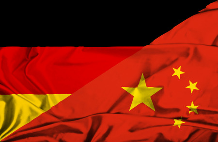 Waving flag of China and Germany photo