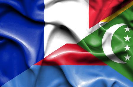 comoros: Waving flag of Comoros and France Stock Photo