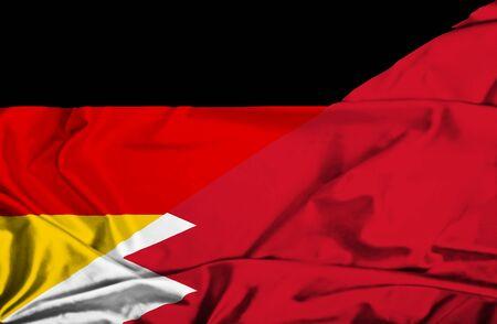 bahrain money: Waving flag of Bahrain and Germany