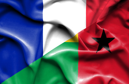 bissau: Waving flag of Guinea Bissau and France Stock Photo