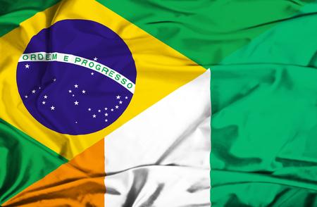 coast: Waving flag of Ivory Coast and Brazil
