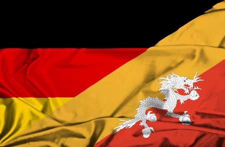 bhutan: Waving flag of Bhutan and Germany