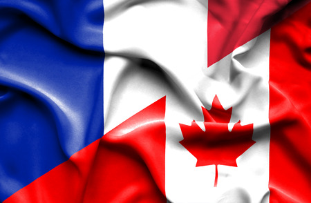immigrant: Waving flag of Canada and France