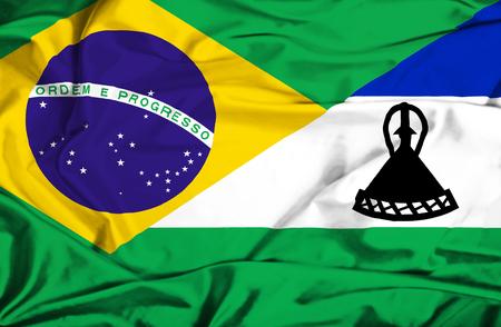 lesotho: Waving flag of Lesotho and Brazil Stock Photo