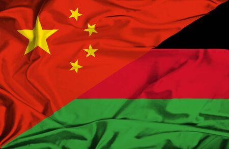 malawi: Waving flag of Malawi and China Stock Photo