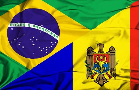 moldavia: Waving flag of Moldavia and Brazil Stock Photo