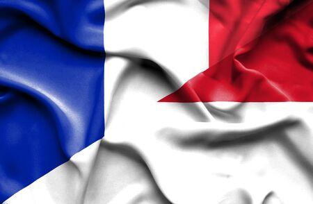 Waving flag of Monaco and France photo