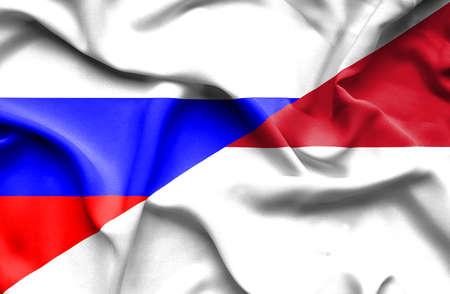 Waving flag of Monaco and Russia photo