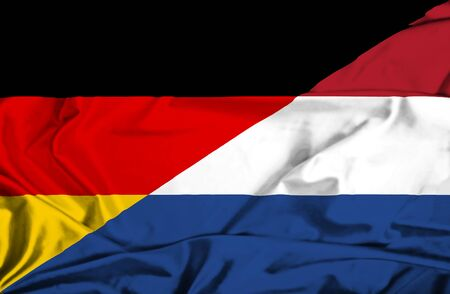 dutch culture: Waving flag of Netherlands and Germany
