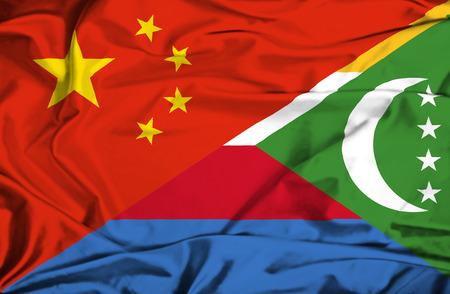 comoros: Waving flag of Comoros and China