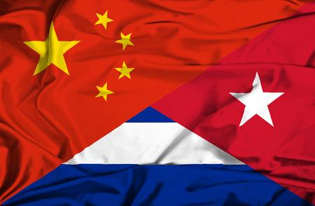 immigrant: Waving flag of Cuba and China