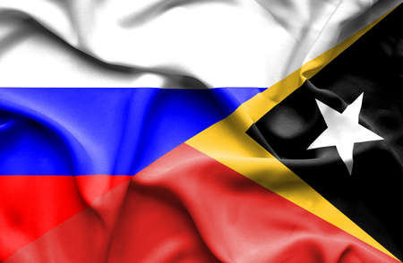 timor: Waving flag of East Timor and Russia