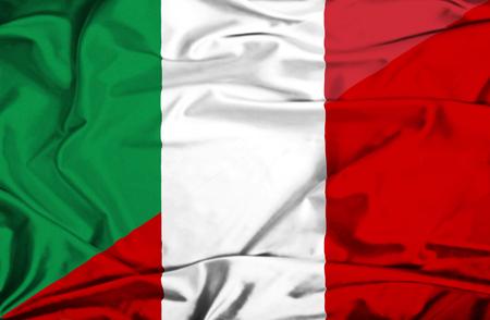 Waving flag of Peru and Italy photo