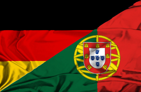 portugese: Waving flag of Portugal and Germany Stock Photo