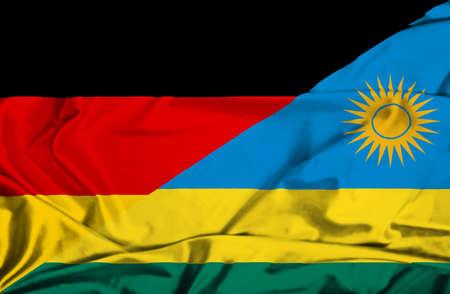 rwanda: Waving flag of Rwanda and Germany Stock Photo
