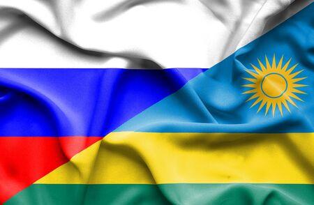 rwanda: Waving flag of Rwanda and Russia Stock Photo