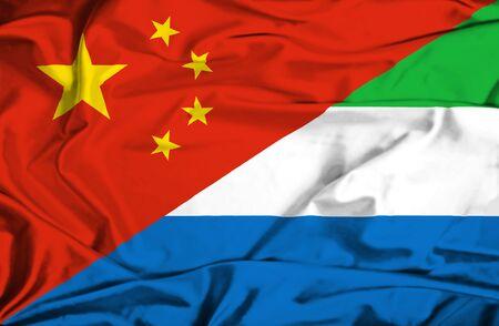 leone: Waving flag of Sierra Leone and China Stock Photo