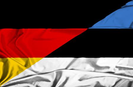 bandera alemania: Ondeando la bandera de Estonia y Alemania Foto de archivo