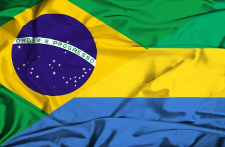 gabon: Waving flag of Gabon and Brazil Stock Photo