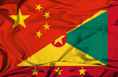 guernsey: Waving flag of Guernsey and China Stock Photo