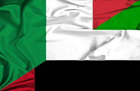 immigrant: Waving flag of United Arab Emirates and italy