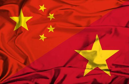 vietnam war: Waving flag of Vietnam and China Stock Photo