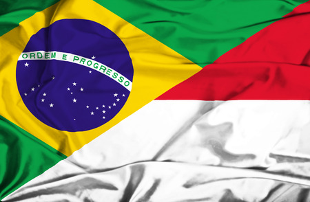 national flag indonesian flag: Waving flag of Indonesia and Brazil Stock Photo