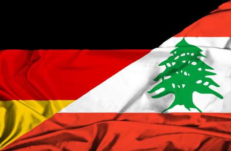 lebanon: Waving flag of Lebanon and Germany Stock Photo