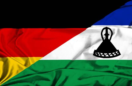 lesotho: Waving flag of Lesotho and Germany Stock Photo