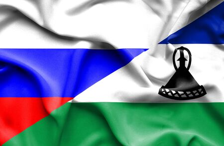 lesotho: Waving flag of Lesotho and Russia Stock Photo
