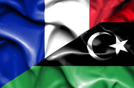 Waving flag of Libya and France photo