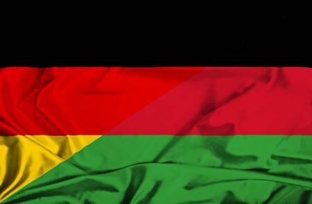 malawian flag: Waving flag of Malawi and Germany Stock Photo