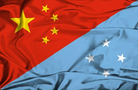micronesia: Waving flag of Micronesia and China Stock Photo