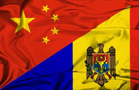 moldavia: Waving flag of Moldavia and China
