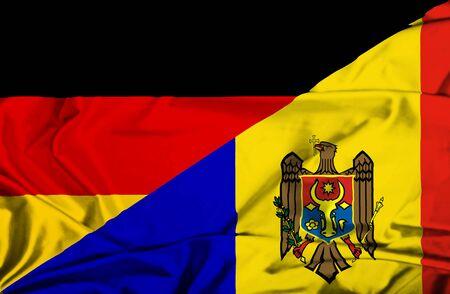 moldavia: Waving flag of Moldavia and Germany Stock Photo