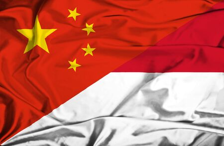 Waving flag of Monaco and China photo