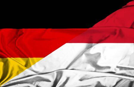 monaco: Waving flag of Monaco and Germany