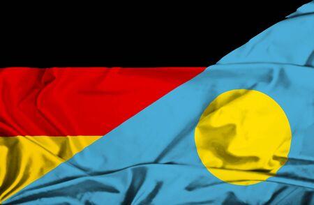 Waving flag of Palau and Germany photo