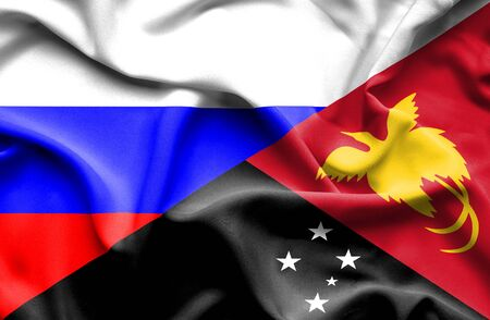 immigrant: Waving flag of Papua New Guinea and Russia