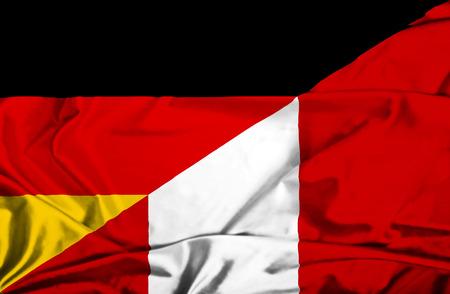 Waving flag of Peru and Germany photo
