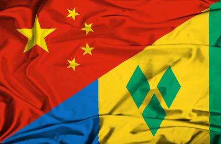 grenadines: Waving flag of Saint Vincent and Grenadines and China