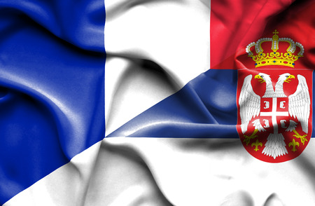 Waving flag of Serbia and France photo