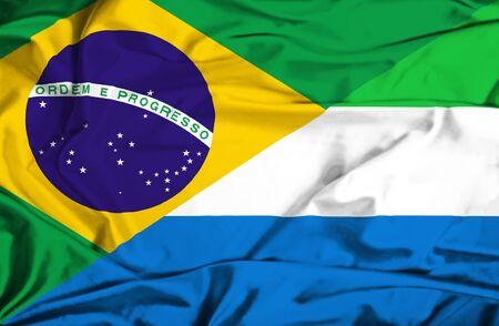 sierra leone: Waving flag of Sierra Leone and Brazil