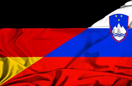 slovenian: Waving flag of Slovenia and Germany Stock Photo