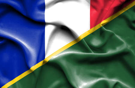 Waving flag of Solomon Islands and France Stock Photo