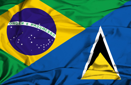 st lucia: Waving flag of St Lucia and Brazil Stock Photo