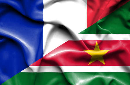 suriname: Waving flag of Suriname and France Stock Photo