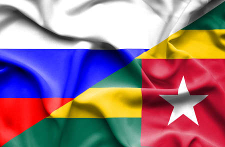 togo: Waving flag of Togo and Russia
