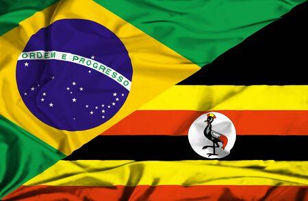 uganda: Waving flag of Uganda and Brazil